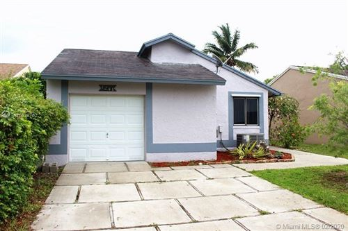 Photo of 1241 SW 110th Ave, Pembroke Pines, FL 33025 (MLS # A10822702)