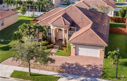 Photo of 1254 NW 140th Ter, Pembroke Pines, FL 33028 (MLS # A10768737)