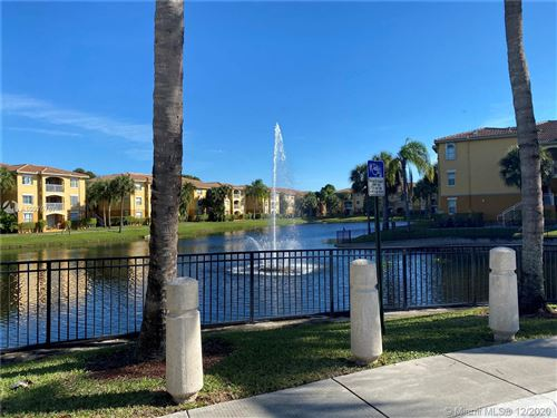 Photo of 9645 NW 1st Ct #1-302, Pembroke Pines, FL 33024 (MLS # A10975767)