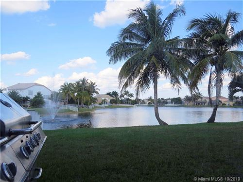 Photo of 1451 NW 159th Ave, Pembroke Pines, FL 33028 (MLS # A10739798)