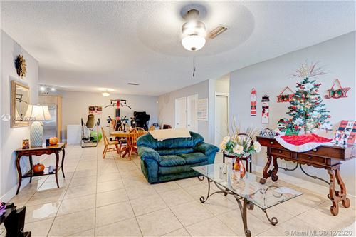 Photo of 4570 SW 43rd Ter, Dania Beach, FL 33314 (MLS # A10949798)