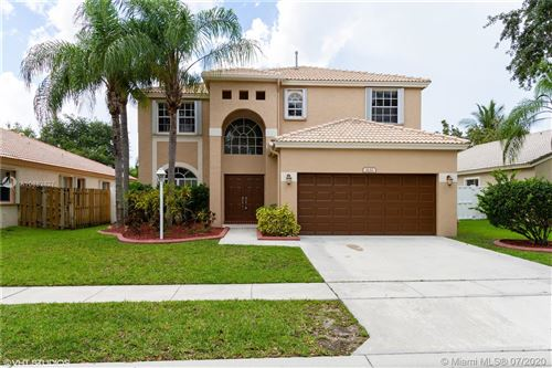 Photo of 1132 NW 130th Ave, Pembroke Pines, FL 33028 (MLS # A10882827)
