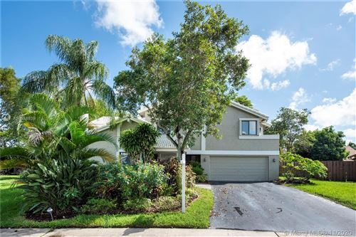Photo of 1140 NW 95th Ave, Plantation, FL 33322 (MLS # A10948839)