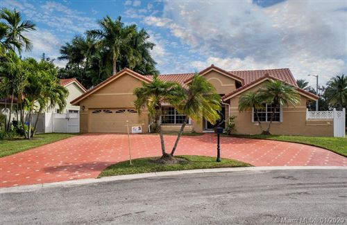 Photo of 165 NW 164th Ave, Pembroke Pines, FL 33028 (MLS # A10773845)