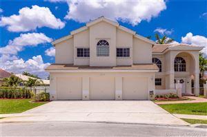 Photo of 935 NW 201st Way, Pembroke Pines, FL 33029 (MLS # A10678849)