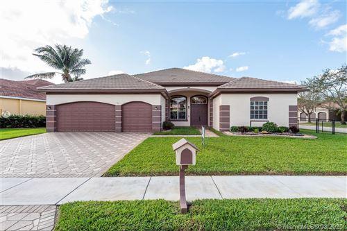 Photo of 15996 SW 14th St, Pembroke Pines, FL 33027 (MLS # A10822877)