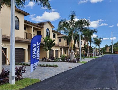 Photo of 9247 NW 16th St, Pembroke Pines, FL 33024 (MLS # A10773882)