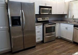 Photo of 3300 W Rolling Hills Cir #405, Davie, FL 33328 (MLS # A10685919)