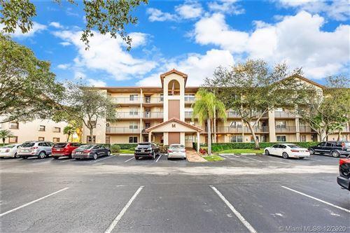 Photo of 1110 SW 125th Ave #403M, Pembroke Pines, FL 33027 (MLS # A10974919)