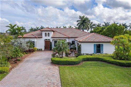 Photo of 8820 Parkside Estates Dr, Davie, FL 33328 (MLS # A10819951)