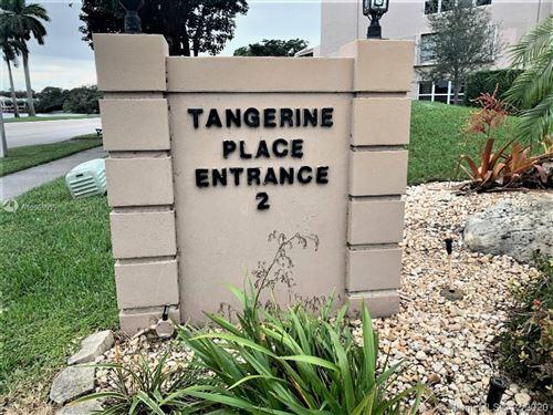 Photo of 9440 Tangerine Pl #403, Davie, FL 33324 (MLS # A10969959)