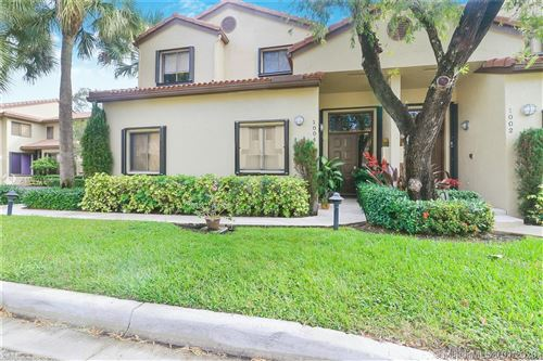 Photo of 1004 NW 105th Ave #C-121, Plantation, FL 33322 (MLS # A10801965)