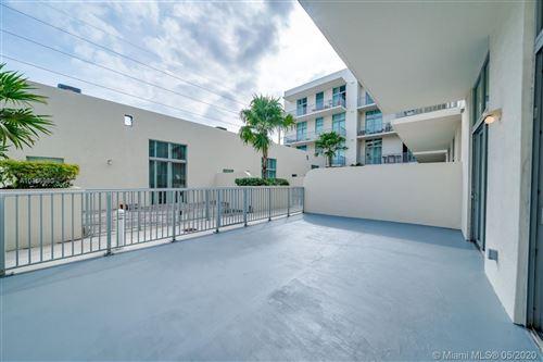 Photo of 2100 Van Buren St #211, Hollywood, FL 33020 (MLS # A10865980)