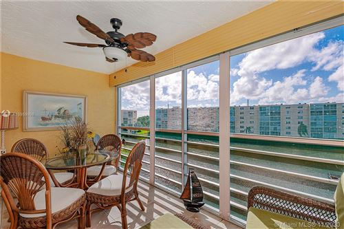 Photo of 311 SE 3rd St #408, Dania Beach, FL 33004 (MLS # A10959998)