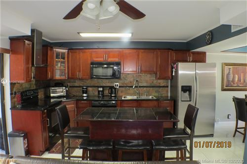 Photo of 12 Cortez Way, Davie, FL 33324 (MLS # A10974999)