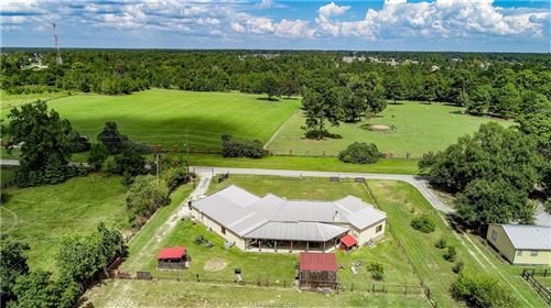 Photo of 8635 Matthews Lane, Magnolia, TX 77354 (MLS # 20014852)