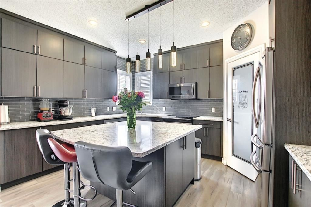 Photo of 143 Evanston View NW, Calgary, AB T2P 1H3 (MLS # A1122212)