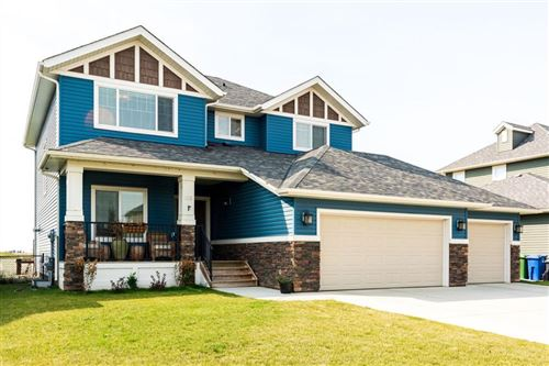 Photo of 285 BOULDER CREEK Drive, Langdon, AB T0J 1X3 (MLS # A1032416)
