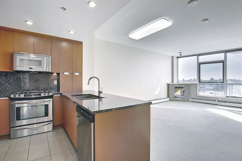 Photo of 99 SPRUCE Place SW #504, Calgary, AB T3C 3X7 (MLS # A1089739)