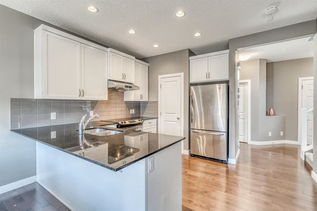 Photo of 21 Panora View NW, Calgary, AB T3K 0R8 (MLS # A1156760)