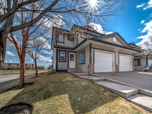 Photo of 240 STONEMERE PL, Chestermere, AB T1X 1N2 (MLS # C4295819)