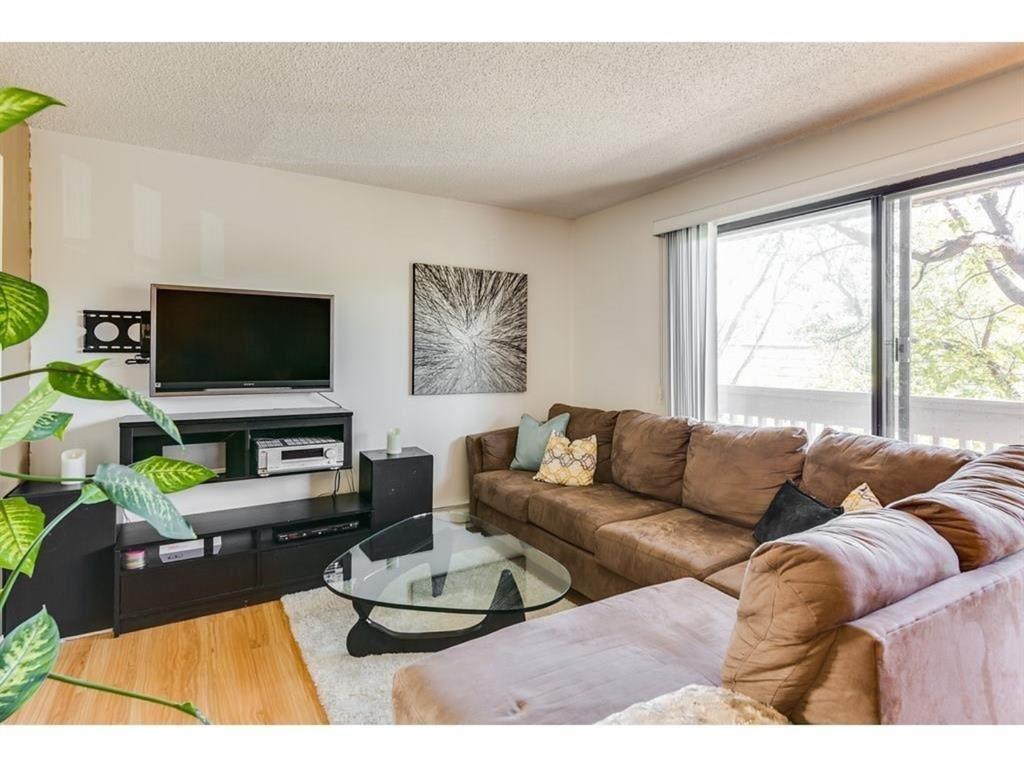 Photo of 709 3 Avenue NW #205, Calgary, AB T2N 0J3 (MLS # A1042895)
