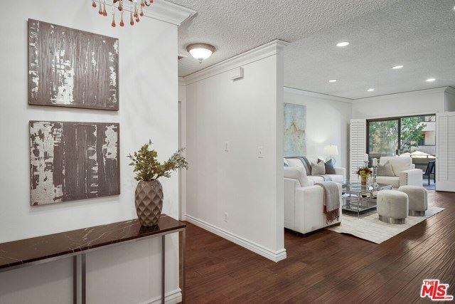 Photo of 651 N Wilcox Avenue #1A, Los Angeles, CA 90004 (MLS # 20659000)