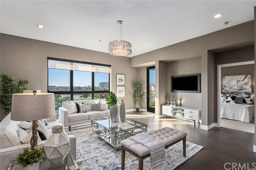 Photo of 402 Rockefeller #410, Irvine, CA 92612 (MLS # NP20229013)