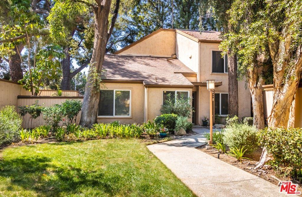 Photo of 22330 Victory Boulevard #804, Woodland Hills, CA 91367 (MLS # 21787024)
