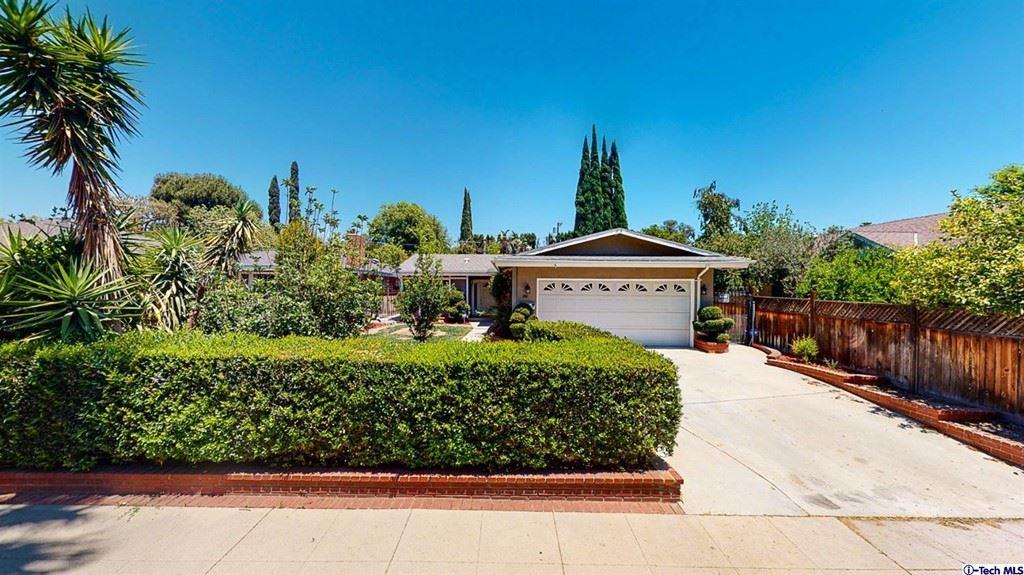 Photo of 17611 Los Alimos Street, Granada Hills, CA 91344 (MLS # 320007035)