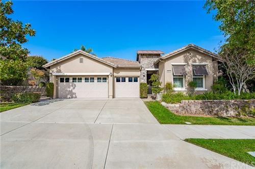 Photo of 9104 Larkspur Drive, Corona, CA 92883 (MLS # IG21054041)