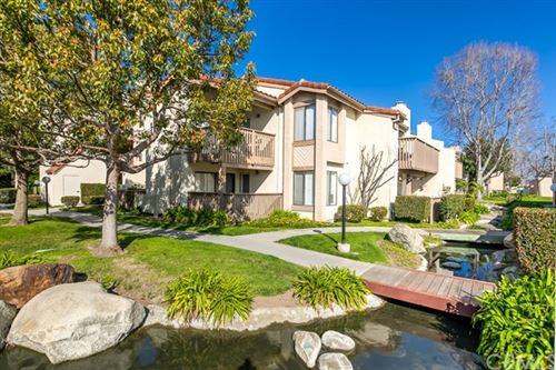 Photo of 4831 Lago Drive #305, Huntington Beach, CA 92649 (MLS # OC20122061)