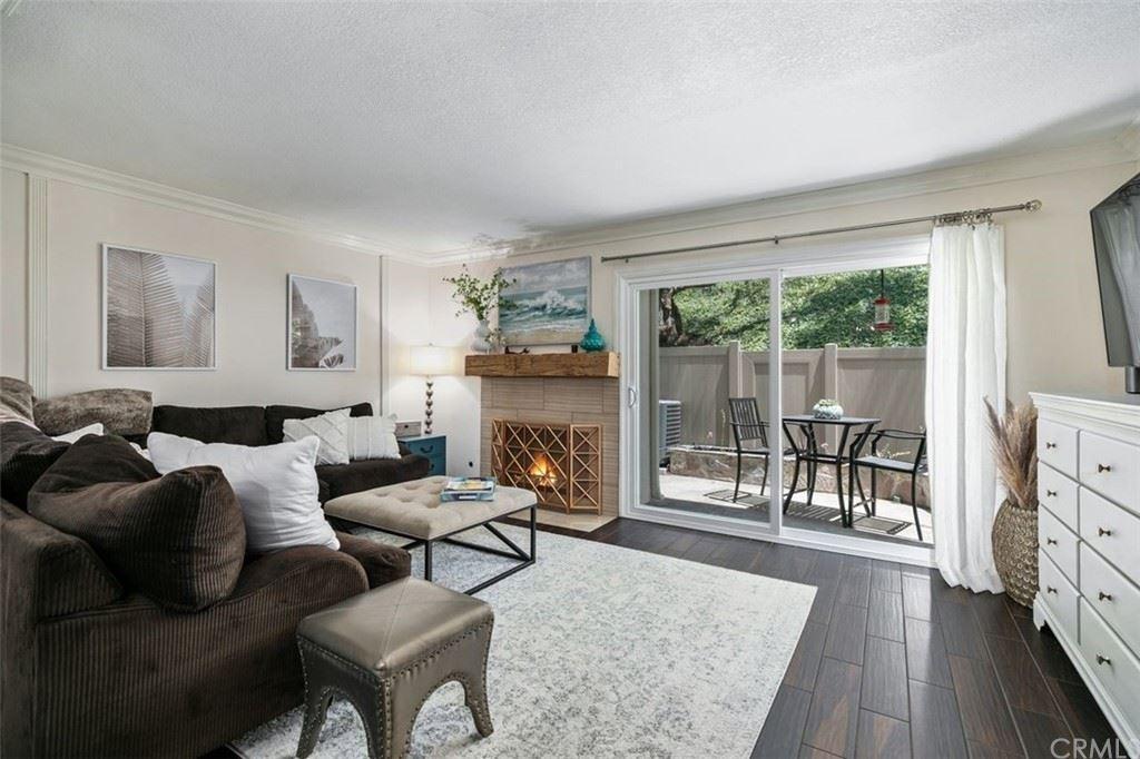 Photo of 209 N Singingwood Street #20, Orange, CA 92869 (MLS # OC21161070)