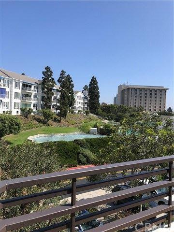 Photo of 950 CAGNEY LANE #308, Newport Beach, CA 92663 (MLS # NP20201076)