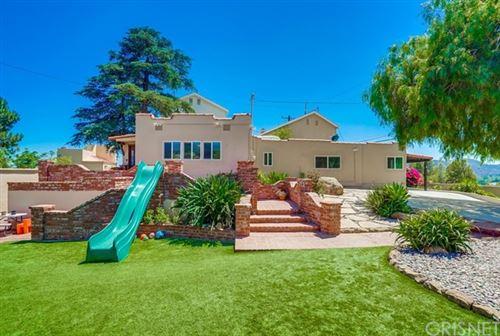 Photo of 21608 Mayan Drive, Chatsworth, CA 91311 (MLS # SR21148078)