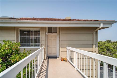 Photo of 20251 Cape Coral Lane #301, Huntington Beach, CA 92646 (MLS # OC21226088)