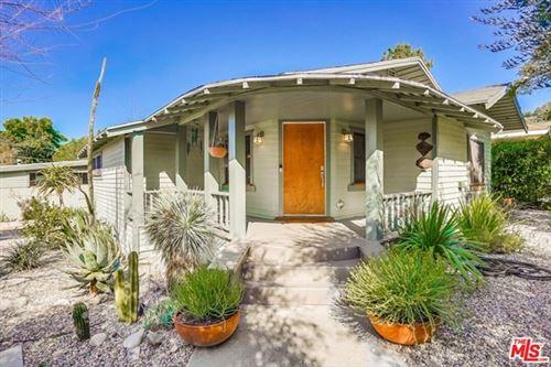 Photo of 1701 N Avenue 56, Los Angeles, CA 90042 (MLS # 21705092)