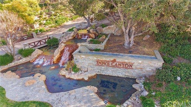 Photo of 51 Foxtail Lane, Rancho Santa Margarita, CA 92679 (MLS # OC21043094)