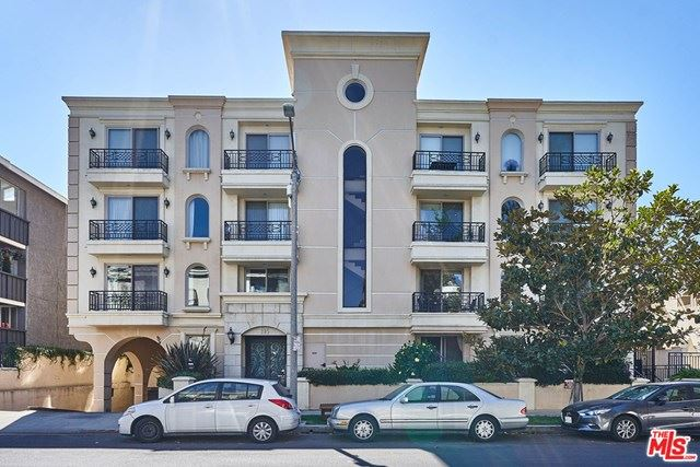 Photo of 135 S Swall Drive #302, Los Angeles, CA 90048 (MLS # 20617100)