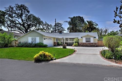 Photo of 23068 Ostronic Drive, Woodland Hills, CA 91367 (MLS # SR21099110)