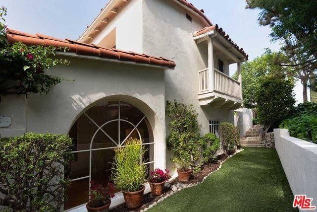 Photo of 3715 Arbolada Road, Los Angeles, CA 90027 (MLS # 21720130)