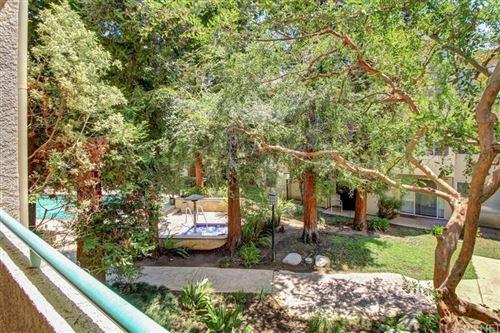 Photo of 7800 Topanga Canyon Boulevard #203, Canoga Park, CA 91304 (MLS # SR21152134)