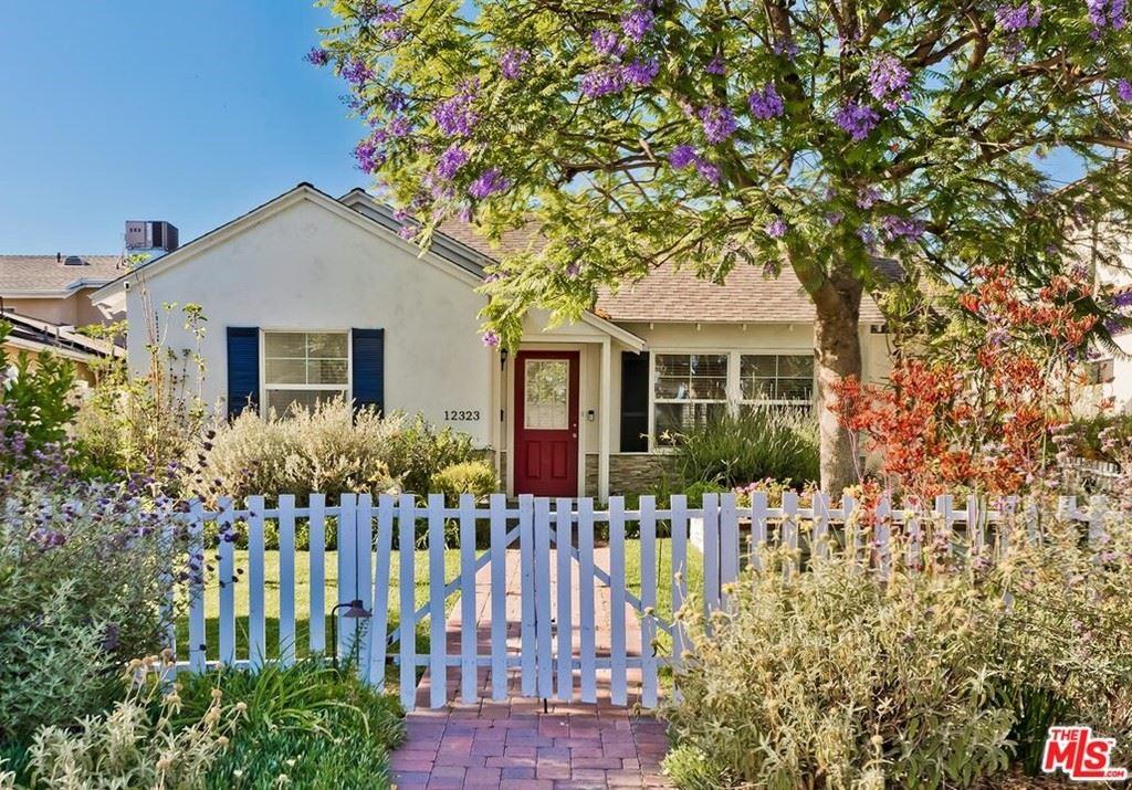 Photo of 12323 Collins Street, Valley Village, CA 91607 (MLS # 21750140)