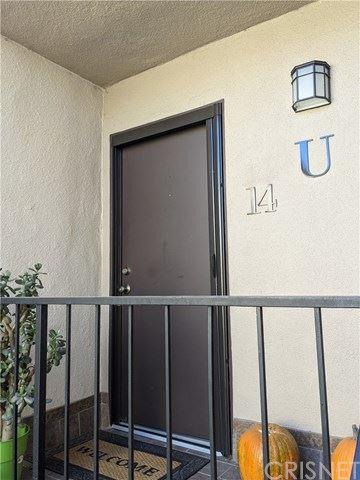 Photo of 24525 Trevino Drive #U14, Valencia, CA 91355 (MLS # SR20240141)
