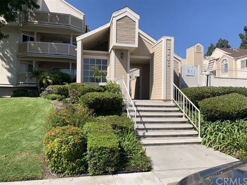 Photo of 3845 Farquhar Avenue #114, Los Alamitos, CA 90720 (MLS # OC21196144)