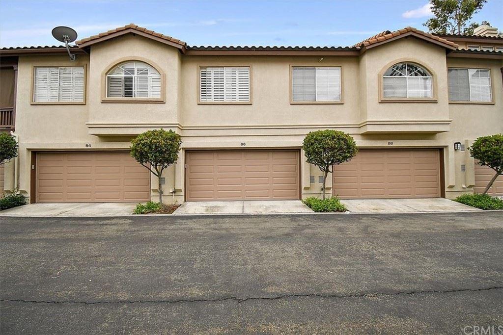Photo of 86 Tierra Plano, Rancho Santa Margarita, CA 92688 (MLS # CV21157160)