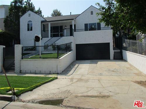 Photo of 1309 S Mansfield Avenue, Los Angeles, CA 90019 (MLS # 21772176)
