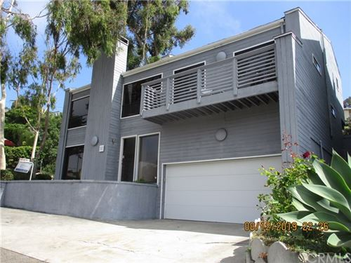 Photo of 1301 Bluebird Canyon Dr, Laguna Beach, CA 92651 (MLS # OC18245176)