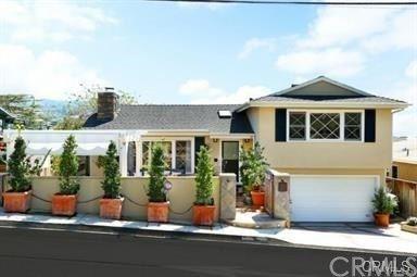Photo of 125 Cypress Drive, Laguna Beach, CA 92651 (MLS # LG20188180)