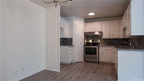 Photo of 18611 Collins Street #E2, Tarzana, CA 91356 (MLS # SR21212181)